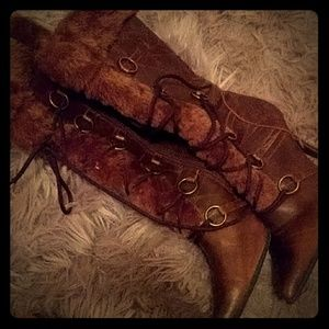 Stiletto boots with fox fur